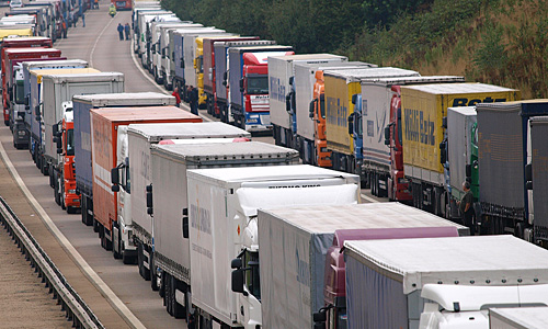 Long lines of trucks are parked on the M20 motorway in the Dover direction lanes at Ram Lane, England, Friday Sept. 12, 2008, after a fire broke out Thursday afternoon on a truck aboard a 30-car shuttle train traveling from England to France using the Channel Tunnel, injuring 14 people. A French official says firefighters have extinguished a blaze in the tunnel under the English Channel, but undersea train traffic remains suspended for a second day. Gerard Gavory, deputy head of the Calais regional administration, told reporters the main fire was put out Friday morning, though firefighters were still putting out some flames. (AP Photo/ Max Nash)